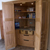 Oak pantry cabinet open